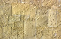 Artistic sandstone wall texture background patterns. Close up Royalty Free Stock Photos