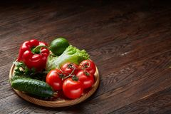 Artistic still life of assorted fresh vegetables and herbs on rustic wooden background, top view, selective focus. Artistic seasoning close-up still life of Royalty Free Stock Photos