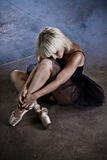 Artistic and sensual ballet dancer in an industry area, blonde w Royalty Free Stock Photo