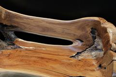 Artistic shaped bench made of one piece of wood trunk Royalty Free Stock Image