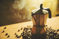 Artistic shot of old coffee maker and coffee beans royalty free stock image