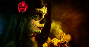 Artistic shot of sugar skull girl with dead roses royalty free stock photo