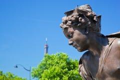 Artistic statue on Alexandre Bridge against Eiffel Tower. Paris, France Royalty Free Stock Photography