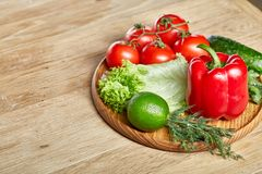 Artistic still life of assorted fresh vegetables and herbs on rustic wooden background, top view, selective focus. Artistic seasoning close-up still life of Stock Image