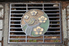 Artistic Street Drain Cover Royalty Free Stock Photos
