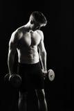 Artistic, strong male flexing Stock Photos