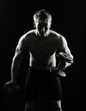 Artistic, strong male, lifting stock photo