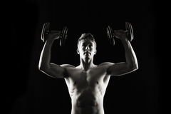 Artistic, strong male, lifting royalty free stock photo