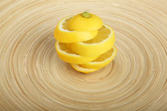 Artistic structure made of lemon slices on wooden plate Royalty Free Stock Photos