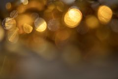 Artistic style bokeh light defocused abstract texture background. Golden yellow bokeh light defocused abstract  background  with copy space Royalty Free Stock Photo