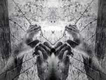 Artistic surreal tortured hands grasping desperately barbed wire. Infrared Stock Photography