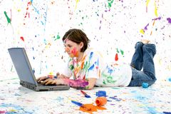 Artistic Teen With Laptop. Beautiful teen girl covered in paint with laptop royalty free stock image