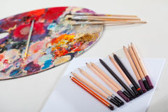 Artistic tools and painting palette Stock Photography