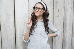 Artistic trendy woman with stylish glasses posing holding paintbrush Stock Photography