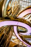Artistic view of Lotte World Mall. Seoul, South Korea - April 6, 2018: Artistic view of Lotte World Mall sky window, staircase and elevator by looking upwards Royalty Free Stock Photos