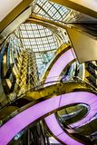 Artistic view of Lotte World Mall. Seoul, South Korea - April 6, 2018: Artistic view of Lotte World Mall sky window, staircase and elevator by looking upwards Royalty Free Stock Photography