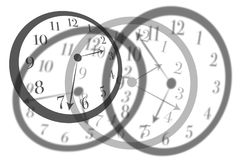 Artistic view round isolated clocks with latin numerals intersect with each other to show time passing and stress in life. Artistic view round isolated clocks Royalty Free Stock Photos