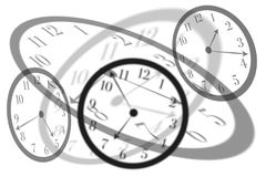 Artistic view round isolated clocks with latin numerals intersect with each other to show time passing and stress in life. Artistic view round isolated clocks Royalty Free Stock Photography