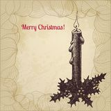 Artistic vintage  Christmas card with candle Royalty Free Stock Photography