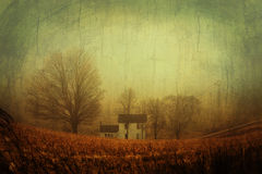 Artistic vintage old farmhouse. On a foggy winter day Royalty Free Stock Images