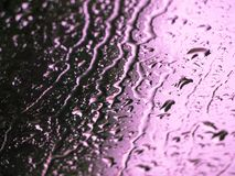 Background raindrops violet royalty free stock photography