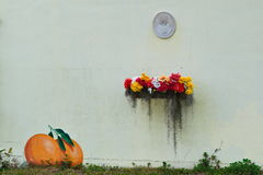 Artistic Wall outdoor. Outdoor white wall decorated with flower box and painting or oranges, famously found in the coastal Florida town of Dunedin Royalty Free Stock Image