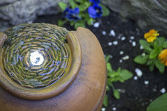 Decorative garden water fountain. Closeup of decorative water fountain in garden Royalty Free Stock Images