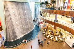 Artistic waterfalls in Dubai Mall stock images