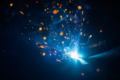 Artistic welding sparks light, industrial background. Artistic welding sparks blue light, industrial background royalty free stock photography