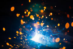 Artistic welding sparks light, industrial background. Abstract welding sparks blue light, industrial background royalty free stock photos