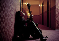 Artistic woman with guitar Royalty Free Stock Image