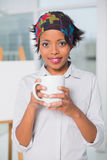 Artistic woman holding cup of coffee Royalty Free Stock Photos