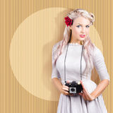 Creative vintage woman holding retro camera Stock Photos