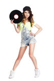 Artistic Woman in Jeans showing Retro Vinyl Record Stock Image