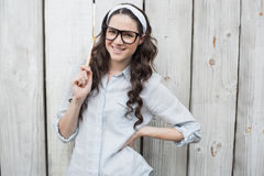 Artistic woman with stylish glasses posing holding paintbrush Stock Photography