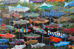 Artistic wooden fish on display at whitehorse. Colourful wooden fish painted by children to mark the entrance to the salmon ladder at whitehorse, yukon Stock Photo