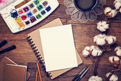 Artistic workplace mock up. With watercolor paper and painting supplies Royalty Free Stock Photo