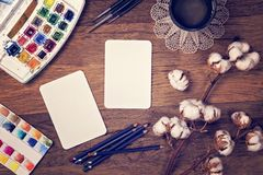 Artistic workplace mock up. With watercolor paper and painting supplies Stock Illustration
