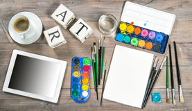 Artistic workplace mock up with painting tools and accessories Royalty Free Stock Images