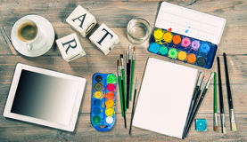 Artistic workplace mock up with painting tools and accessories Royalty Free Stock Photo