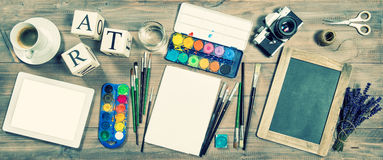 Artistic workplace mockup. Office supplies, digital tablet, vint Royalty Free Stock Image