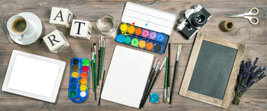 Artistic workplace mockup. Watercolor, brushes, digital tablet, Royalty Free Stock Image