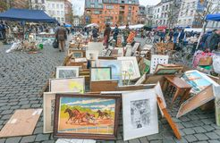 Artistic works and paintings for sale on outdoor flea market with old bargains, antique stuff, vintage decor. BRUSSELS, BELGIUM - APR 3: Artistic works and Stock Photo