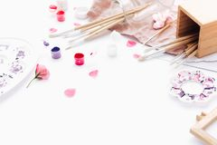 Artistic workspace, Brushes, paints, watercolor and a palette. stock photos