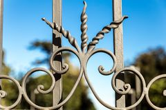 Artistic wrought iron. In an ancient Sicilian gate Royalty Free Stock Photography