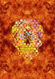 Abstract religious artistic multicolored skull in a fiery artwork as a unique background. Artistic yellow skull background for fashion tattoos with flower icon stock image