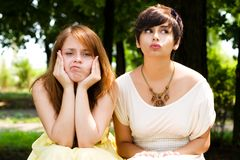 Artistic young girls in the park Royalty Free Stock Images