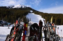 Artistically captured image with skis close up and skiing slops on a sunny day in winter. Nakiska is a ski resort in western Canada, in the Kananaskis Country Stock Photo