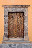 Artistically carved wooden door Royalty Free Stock Images