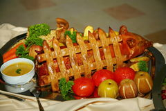 Artistically decorated dish from the chef - suckling pig baked in apples stock photo